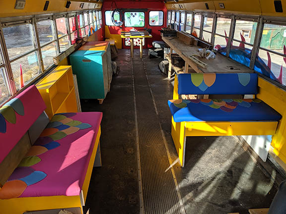 This image has an empty alt attribute; its file name is web_bus_inside_longview.jpg